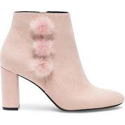 Boots rose à talon avec pompons fourrure